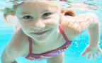 Underwater view of young girl in swimming pool